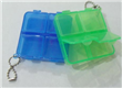 Four compartments pill box with keychain